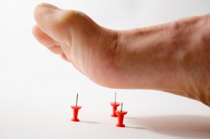 symptoms of nerve damage in legs and feet